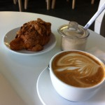 Latte and almond croissant at the Astor Row Cafe, Harlem